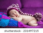 newborn girl sleeps under a... | Shutterstock . vector #231497215