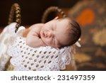 dreaming naked newborn baby | Shutterstock . vector #231497359