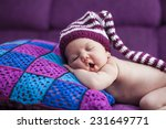 baby girl in a knitted hat... | Shutterstock . vector #231649771