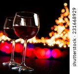 Two Red Wine Glass Against...
