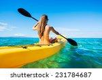 Woman Kayaking In The Ocean On...