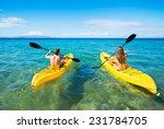 couple kayaking in the ocean on ... | Shutterstock . vector #231784705