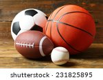 sports balls on wooden... | Shutterstock . vector #231825895