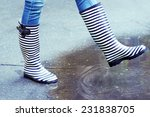 girl in rubber boots outdoors... | Shutterstock . vector #231838705