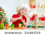 Kid Girl In Santa Hat Making...