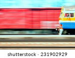 the train moves past a freight... | Shutterstock . vector #231902929