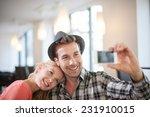 trendy couple taking a selfie... | Shutterstock . vector #231910015