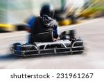 a man is driving go kart with... | Shutterstock . vector #231961267