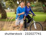 elder couple exercising in the... | Shutterstock . vector #232027741