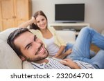 Cute Couple Relaxing On Couch...