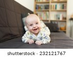 laughing baby on sofa ... | Shutterstock . vector #232121767
