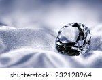 jewel on satin fabric background | Shutterstock . vector #232128964
