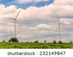 eco power in wind turbine farm | Shutterstock . vector #232149847
