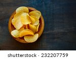 Crispy Potato Chips In Bowl On...