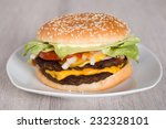 closeup of burger in plate on... | Shutterstock . vector #232328101