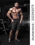 bodybuilder posing in the gym | Shutterstock . vector #232342075