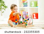 kid boy plays with educational... | Shutterstock . vector #232355305