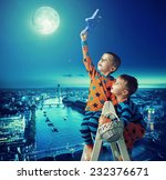 young brothers reaching stars | Shutterstock . vector #232376671