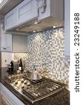 Stock photo beautiful kitchen stove and backsplash made from glass tile 23249188