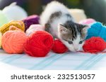 Stock photo white kitten plays with balls of yarn 232513057