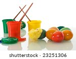 Easter eggs and different colored paints - isolated with reflection - stock photo