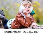 girl in park | Shutterstock . vector #232562107
