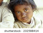 Stock photo poverty portrait of a poor little african girl lost in deep thoughts 232588414