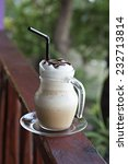 Coffee latte with whipped cream and chocolate