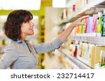 elderly woman making shopping... | Shutterstock . vector #232714417