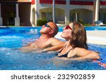 loving couple relaxing in... | Shutterstock . vector #232902859