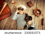 Stock photo happy kid dressed in sailor child playing with dog baby having fun at home travel and adventure 233031571