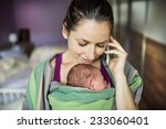 newborn baby hold by mother in... | Shutterstock . vector #233060401