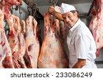 Portrait Of Happy Male Butcher...
