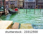 A gondola anchored on Grand Canal in Venice - stock photo