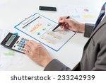 businessman analyzing report ... | Shutterstock . vector #233242939