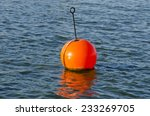 Orange Buoy In  Sea On Water