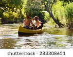 People Boating On Small River...