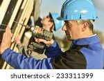 construction worker using... | Shutterstock . vector #233311399