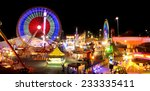 Carnival Rides In Action At...