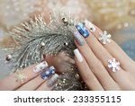 Manicure With Snowflakes On...
