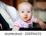 baby girl with food on her face | Shutterstock . vector #233556151