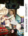 Happy Little Girl Riding On A...
