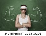 Stock photo funny sport nerd with huge fake muscle arms drawn on the chalkboard 233563201