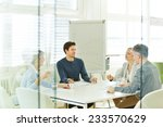 business team in a consulting... | Shutterstock . vector #233570629