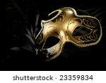 ornate carnival mask over black ...