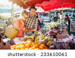 A Young Couple Buying Fruits...