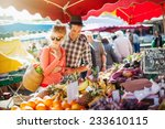 a young couple buying fruits... | Shutterstock . vector #233610115