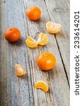 ripe tasty tangerines on wooden ... | Shutterstock . vector #233614201