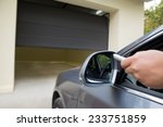 driver opens the garage with... | Shutterstock . vector #233751859