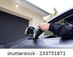 man by using remote garage... | Shutterstock . vector #233751871